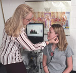 a speech language hearing therapist working with a patient