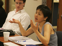 Professor Oh discussing her work with colleagues